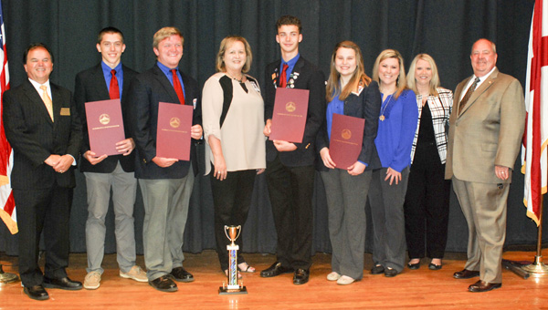 The Jemison High School robotics team was recognized on Tuesday after finishing second in a nationwide engineering competition. Pictured are Superintendent of Education Tommy Glasscock, Sawyer Smith, Dylan Levering, Jemison Principal Diane Calloway, Fletcher Brantley, Brynn Elliott, and state representatives April Weaver and Jimmy Martin. (Photo by Anthony Richards)