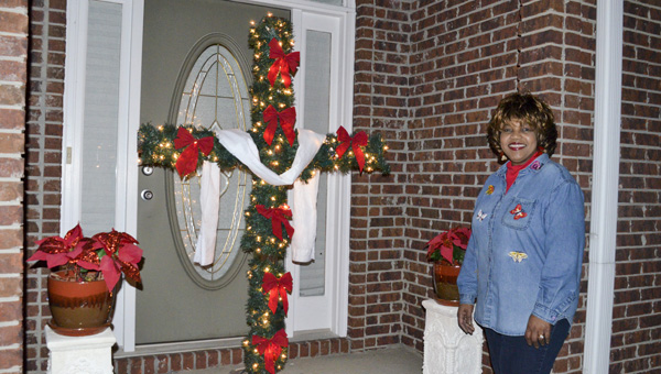 "Mae Carol Sails' ""CHRISTmas cross"" is a sign of what the Christmas season means to her. (Photo by Anthony Richards)"